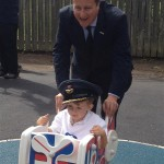 David Cameron playing with a child on our play equipment at RAF Brize Norton