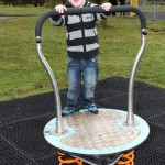 proludic playground equipment being used by a very happy child!