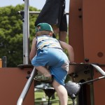 Small infant having a go on Proludic's Playground offering