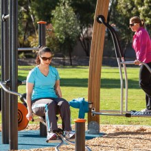 social fitness space in use by three women on proludic equipment