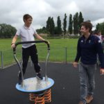 School Boy playing on Proludic Adventure Play Children's Play Equipment at West Park