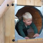 Great Gedling Site Opening for New Play Area Image 6 Child Crawling through Tunnel Play Equipement