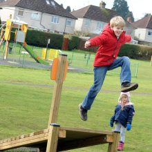 HarpendenTownCouncil Picture 9 version 2 of boy leaping off of adventure play platform