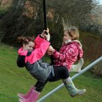 HarpendenTownCouncil Picture 7 girls playing on double swing on example of Proludic children's play equipment