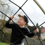 HarpendenTownCouncil Picture 6 boy playing on Proludic play equipment
