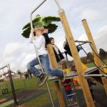 HarpendenTownCouncil Picture 3 boy playing on Proludic themed adventure play play equipment