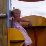 smiling child playing on example of proludic school play equipment