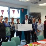Put the fun back into fundraising image 7 proludic team holding cheque