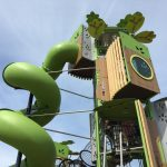 green slide and climbing tower forest themed adventure play from kanope range