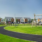 Proludic natural wooden outdoor playground equipment on a housing estate