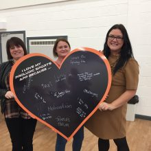I love my Proludic Sports App reasons - group from Thornley Parish Council holding heart shaped chalk board